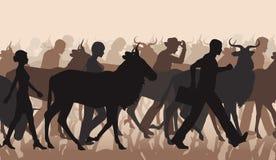 Austauschende Leute und wilderbeest Stockfotos