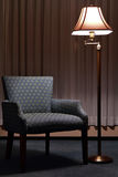 Austere Armchair and Floor Lamp Stock Photos