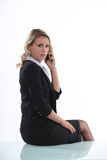 Austere businesswoman. Talking on her mobile phone stock photography