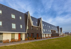 Austere design row houses. Modern design row houses in a newly developed family residential area stock photo