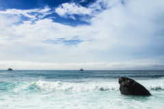 Austere rock ocean scene. An austere scene of distant rocks and islands Stock Photo