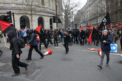 Austerity Protest in London. A breakaway group of anarchist protesters march through the streets of the British capital during a large austerity rally on March Royalty Free Stock Photos