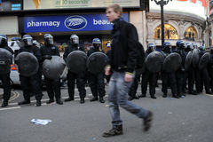 Austerity Protest in London. Police in riot gear on standby at Piccadilly Circus in central London after voilent clashes during a large austerity rally on March Stock Images