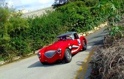 Austin Healey 1954 100 BN1 en la acción de la raza Foto de archivo