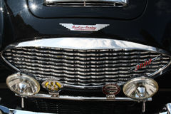 Austin-Healey 3000. Oldtimer successful sports car, front grille, lights, sun Royalty Free Stock Photography