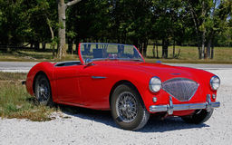 Austin Healy Sports Car. 1960's red Austin Healy convertible sports car, two seater Royalty Free Stock Photo