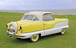 Austin metropolitan classic car. Photo of a 1960's austin metropolitan car in two tone yellow and white Stock Images