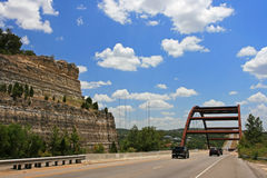 Austin 360 or Penneybacker Bridge. AUSTIN,USA - JULY 19, 2008: Vehicles driving across Austin 360 Bridge, opened on Dec 3, 1982, against blue sky and dramatic Stock Photo