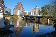 Austin River Life. Austin Texas downtown buildings reflected on Town Lake with the paddle of a riverboat in foreground royalty free stock photography