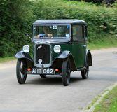 Austin Seven. The Austin 7 is an economy car that was produced from 1922 until 1939 in the United Kingdom by Austin. It was nicknamed the `Baby Austin` and was royalty free stock photography