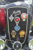 Austin Seven radiator grill with motoring badges. Saffron Walden, Essex, England - June 21, 2015: Austin Seven radiator grill with motoring badges Royalty Free Stock Photo