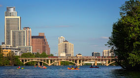 Austin Skyline and Kayaking on Colorado River in Texas. Austin, Texas skyline during the day with kayakers enjoying the Colorado River Stock Photography