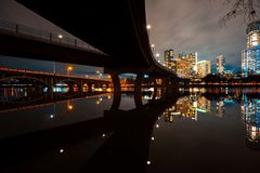 Austin skyline at night and Lamar pedestrial Bridge with bright illuminated buildings reflecting in Lady Bird Lake. Austin skyline at night and Lamar pedestrian royalty free stock photography