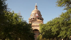 Austin Texas Capital Building United States Flags Wave Downtown Skyline. Sunny blue skies in Austin Texas a capital city stock footage
