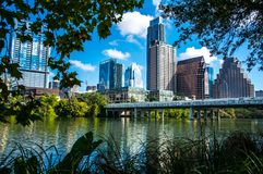Austin Texas Downtown skyline through the Summer Trees and leaves royalty free stock images