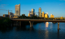 Austin Texas Growing City with Cranes Sunset Golden Hour relfections Royalty Free Stock Photos