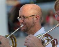 A perfect french horm embouchure. AUSTIN, TEXAS - JUNE 1 2014: closeup of a french horn player at an outdoor concert Stock Image