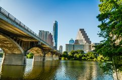 Congress Avenue Bats Bridge and skyscrapers in Austin TX. Austin, Texas - June 1, 2014: Skyscrapers and the Ann W. Richards Congress Avenue Bridge bats bridge Royalty Free Stock Image