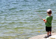 Little boy fishing in the reservoir near Austin stock photos