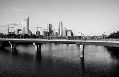 Austin Texas Monochrome crane madness Skyline Progress 2015. The new austin texas , USA skyline cityscape with construction cranes and the colorado river or Stock Photos