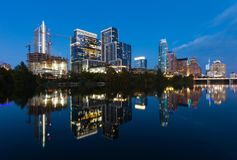 Austin, Texas with new buildings rising, reflecting in Lady Bird Lake during sunset / Austin Skyline and new constructions Stock Images