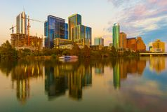 Austin, Texas with new buildings rising, reflecting in lady Bird Lake during sunset / Austin Skyline and new constructions. Austin, Texas with new buildings stock photo
