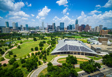 Austin Texas Powered by Solar Panels on Rooftop of Large building Downtown Skyline Cityscape. On a nice blue summer day in central texas over looking Butler Royalty Free Stock Images