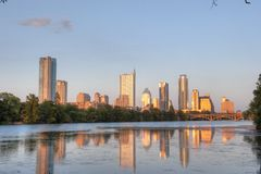Austin, Texas skyline reflection. Skyline of Austin, Texas reflected in lake on sunny day Stock Images