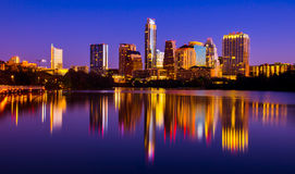 Austin Texas Skyline 2015 Riverside Pedestrian Bridge Mirror Reflection Cityscape. Deep blue waters of Town Lake or Lady bird Lake in Austin with a perfect stock photos