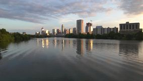 Austin, Texas Skyline 2018. A serene view of the city of Austin, Texas at sunrise, reflected in the waters of Ladybird Lake