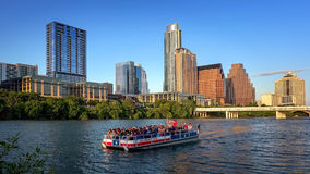 Austin, Texas Skyline and Tour Boat on Colorado River. Austin, Texas skyline and tour boat packed with tourist on the Colorado River royalty free stock photos
