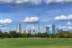 Austin, Texas skyline from Zilker Park. Zilker Park with skyline of Austin, Texas against blue skies Royalty Free Stock Photos