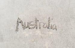 Austrália escrita na areia fotografia de stock royalty free