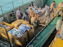 Australian Navy sailors unloading international disaster relief. SANTA FE,BANTAYAN,PHILIPPINES - December 3rd 2013:Australian Navy sailors unloadingi Stock Photography