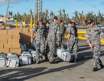 Australian  Navy sailors unloading international disaster relief. SANTA FE,BANTAYAN,PHILIPPINES - December 3rd 2013:Australian Navy sailors unloadingi Stock Photos