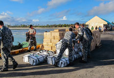 Australian Navy sailors unloading international disaster relief. SANTA FE, BANTAYAN, PHILIPPINES - December 3rd 2013:Australian Navy sailors unloadingi Stock Photography