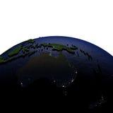 Australië bij nacht op model van Aarde met in reliëf gemaakt land Royalty-vrije Stock Afbeelding