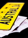 Australia. Abstract image of Australia travel concept with car plate and two passports on black background Royalty Free Stock Image