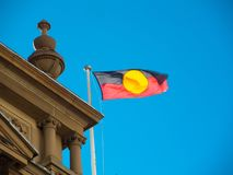 Australia aboriginal flag flying on Sydney Townhall building. An Australia aboriginal flag flying on Sydney Townhall building stock images