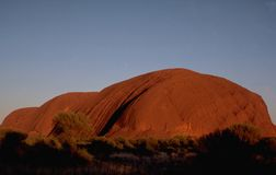 Australia: Ayer`s Rock at sunset stock images