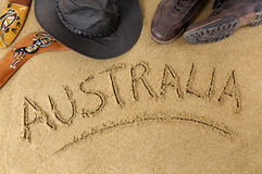 Australia beach outback boomerang. Australia outback or beach background with boomerang, bush hat and boots Stock Image