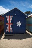 Australia, beach house, hut with flag. Colorful beach huts also bathing boxes at Brighton Beach near Melbourne, Australia Royalty Free Stock Photography
