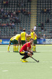 Australia beats Spain. THE HAGUE, NETHERLANDS - JUNE 2: Manel Terraza (Spain) squats down in disappointment after losing the match against Australia (huddling in Stock Photos