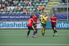 Australia beats Spain during the World Cup Hockey 2014. THE HAGUE, NETHERLANDS - JUNE 2: Australian Hayward lifts his stick to control a high bal, surrounded by stock images