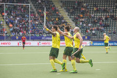 Australia beats Spain during the World Cup Hockey 2014. THE HAGUE, NETHERLANDS - JUNE 2: Australian players Govers, Gohades and Hammond celebrating a goal during royalty free stock photography