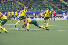 Australia beats Spain during the World Cup Hockey 2014. THE HAGUE, NETHERLANDS - JUNE 2: Australian Turner is shooting the ball in the direction of the goal royalty free stock images