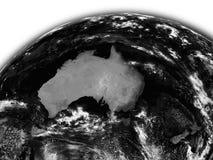 Australia on black Earth Stock Photography