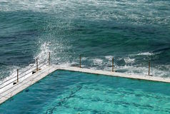 Australia: Bondi swimming pool and breaking wave Royalty Free Stock Images