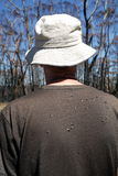 Australia: bushwalking man with flies on back Stock Photography