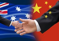 Australia China Chinese Political Influence Flag. A conceptual image with the Australian and Chinese flags showing China`s power over smaller countries royalty free stock photos